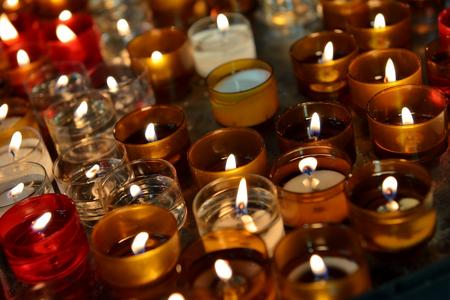 firing: Firing church candles in dark interior
