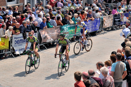 road cycling: HALLE, BELGIUM-JUNE 24, 2015: Participants of cycling race cross historical center of Halle