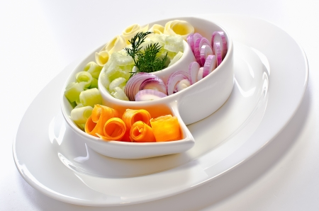 Vegetables salad on a white plate photo