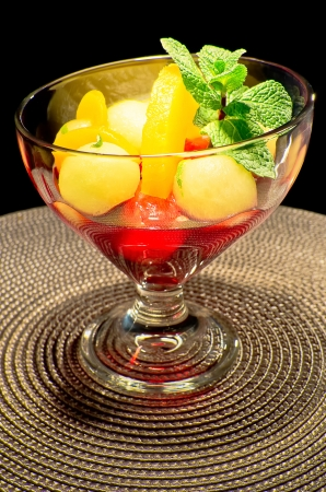 Melon pineapple and apricots salad in a glass coup