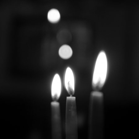 Candles against black background  Stock Photo