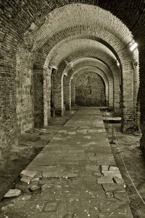 Corridor in an old brick castle photo