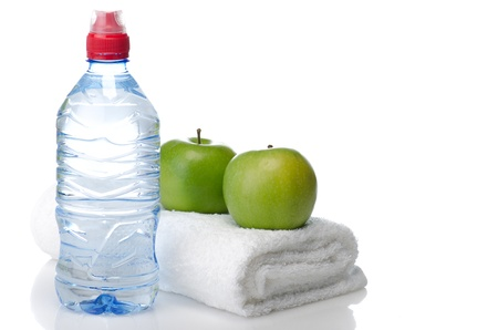 Fitness equipment towel, water, apples Stock Photo