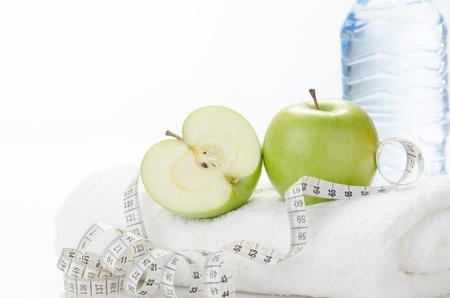 Fitness equipment towel, apples, water, measuring tape,