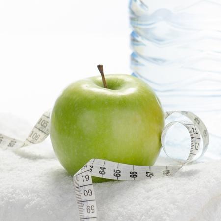 Fitness equipment towel, apple, water, measuring tape