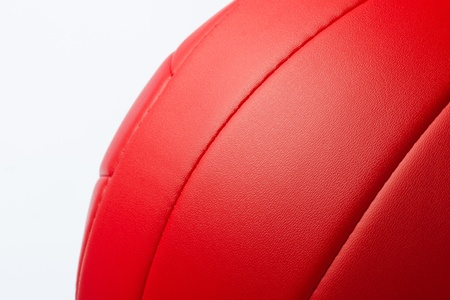 Red volley ball against  white background photo