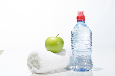 Fitness equipment  water, apple, towel