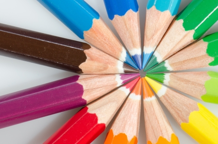 Color pencils arranged in roygbiv on white background photo