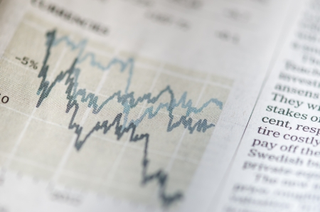 Showing a newspaper about stock market