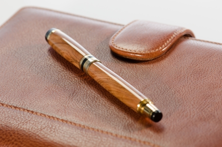 Pen and  leather notebook detail