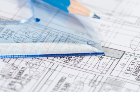 Blueprints, pencil and square drawing against a  white background