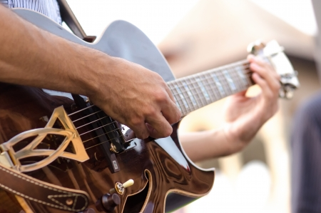 Man's hands playing a guitar in a jazz show Stock Photo - 15139696