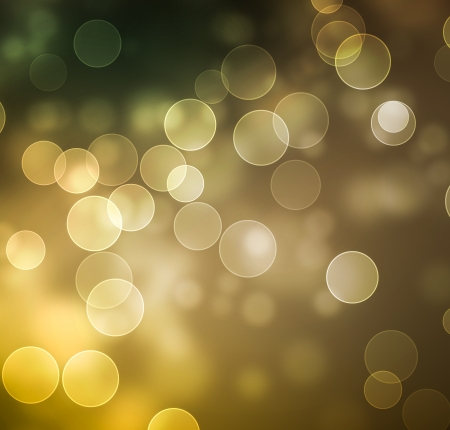 Circles of light on green , gold, brown background with space for your text