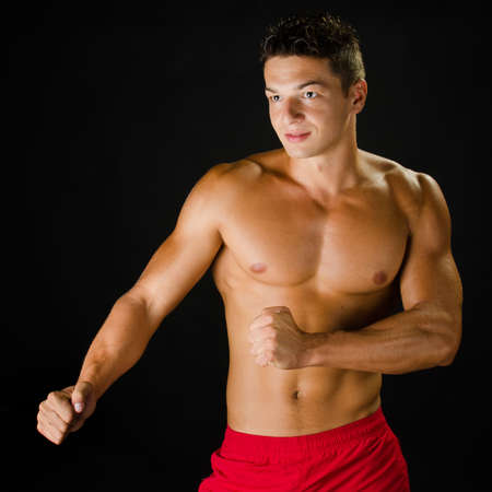 Image of muscular man in defending position posing in studio Stock Photo - 16651255