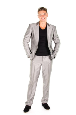 Portrait of young man in suit standing against white background Stock Photo - 16650626