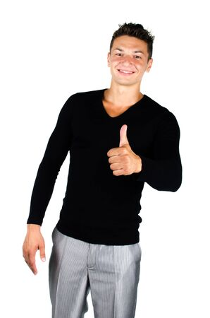 Portrait of happy young man giving you thumbs up against white background photo