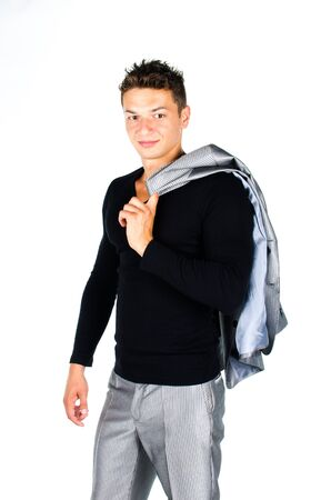 over shoulders: Young man holding coat over shoulders isolated on white background Stock Photo