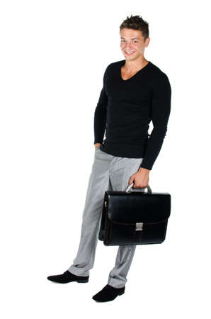 Young man with briefcase standing against white background Stock Photo - 16650353