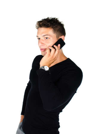Young man with cell phone standing against white background Stock Photo - 16650704