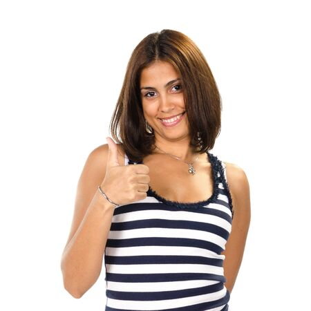 Portrait of young woman with thumbs up against white background