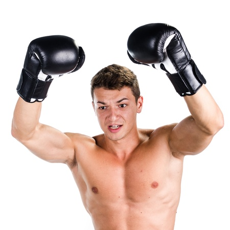 Boxer showing victory against white background photo