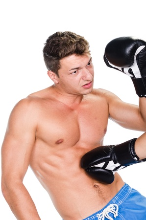 Boxer receiving a stomach punch against white background photo