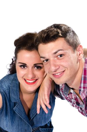 Portrait of young couple smiling to camera against white background Stock Photo - 16651327