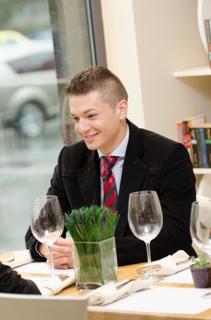 Young business man during lunch time smiling  photo