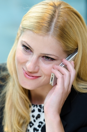 Young business woman talking on the phone during lunch time photo