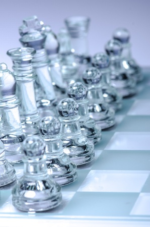 Glass chess in position to start the game  photo