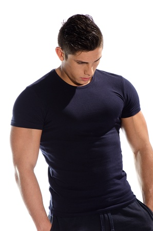 Image of muscular man posing in studio against white background  Stock Photo