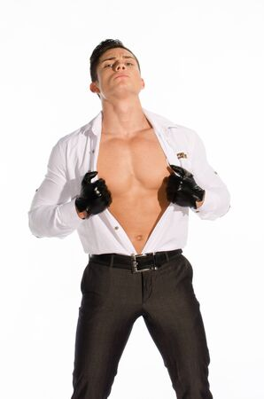 Portrait of young muscular man unbuttoned his shirt against white background