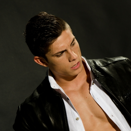 shirt unbuttoned: Portrait of young man wih leather jacket and unbuttoned white shirt