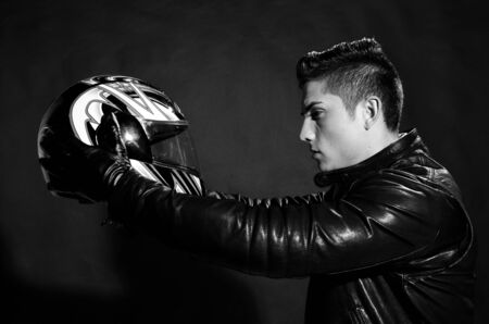 Passionate biker with his helmet black and white  photo