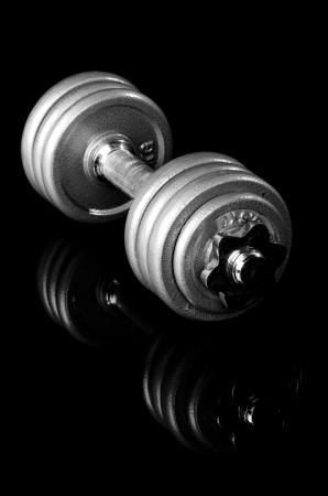 Dumbbells isolated on black  background photo