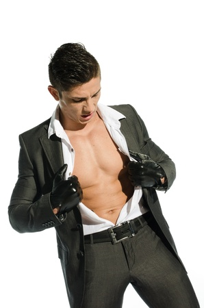 Portrait of young muscular man unbuttoned his shirt against white background photo