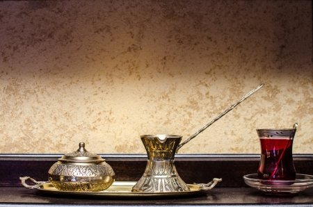 Turkish tea pot and cup on wooden table   photo