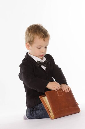 Portrait of young child with an notebook against white background Stock Photo - 17866281