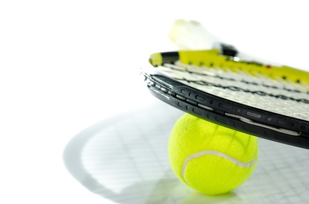 Tennis ball and racket against a white background Stock Photo
