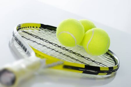 tennis serve: Tennis balls and racket against a white background Stock Photo