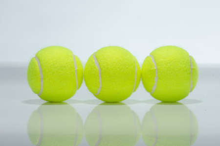Three tennis balls against a white background photo