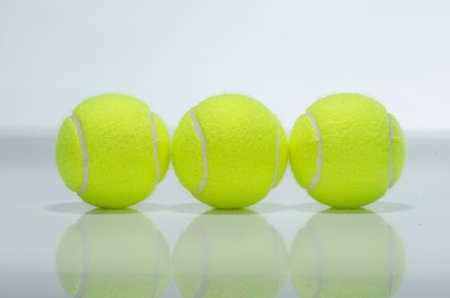 Three tennis balls against a white background photo