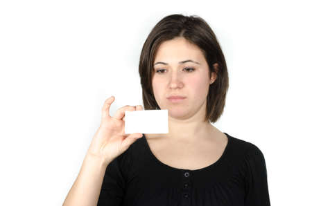 Portrait of young woman showing a business card against white background photo