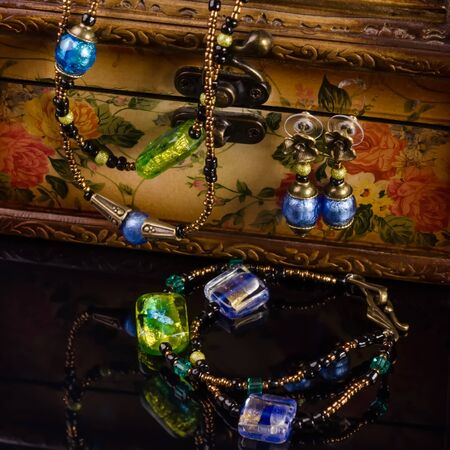 Handmade jewellery necklace and earings presented on jewellery box photo