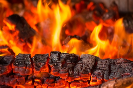 coal fire: Pieces of wood burning Stock Photo