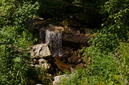 Mountain river flowing through the rocks photo