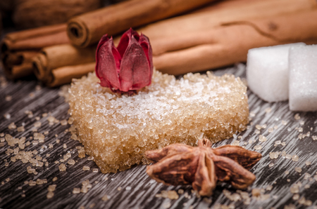 brown sugar: Heart shaped brown sugar and star anise  on wooden surface