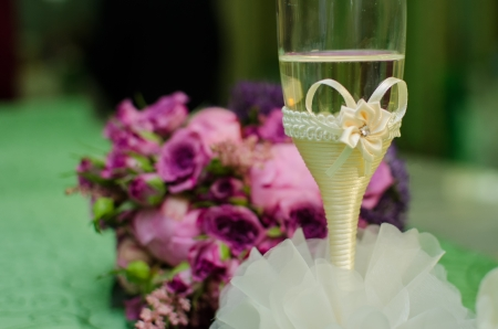Floral arrangement and champagne glass   for table    Stock Photo