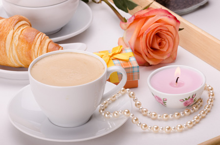 Breakfast on wooden tray with genuine pearls, present box and a rose