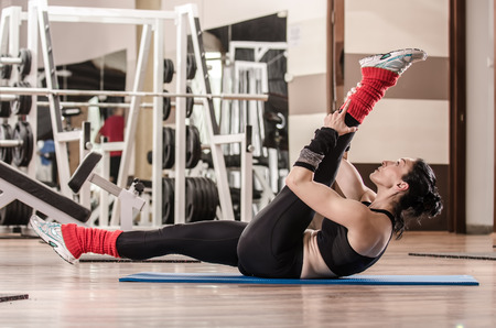 Instructor woman showing Pilates exercises in a gym photo
